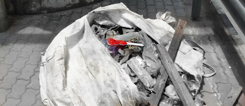 bangkok_protests_red_tools_in_a_trash